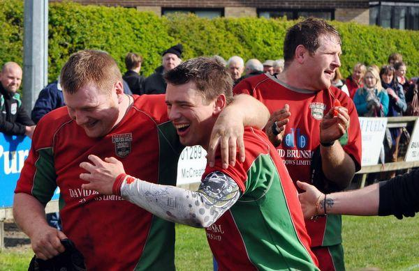 Keighley News: From left, Keighley's Craig Spencer,  Alex Brown and Leigh Sugden celebrate  promotion play-off glory. Pictures: Eddie Budd