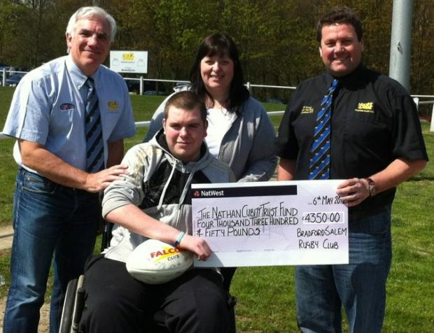 Nathan Cubitt receives a £4,350 cheque for his trust fund from proceeds of the veterans' match between Bradford Salem and Keighley at Shay Lane. Picture, back from left, are Salem chairman John Dobson, Nathan's mum Sue and match organiser Paul Rae