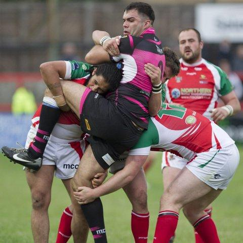 Jy-Mel Coleman and Cougars team-mates repel a Featherstone raid