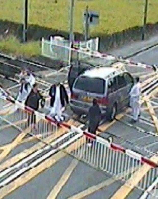 A CCTV image of the family's car on the level crossing