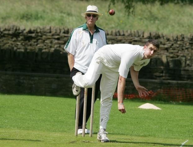 Bradley's opening bowler Jack Price on his way to 2-29 against Barrowford