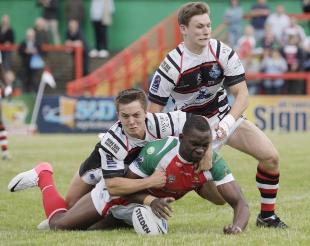 Richie Barnett scores one of his three tries  Picture: Charlie Perry