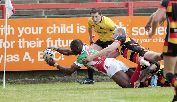 RICH PICKINGS: Richie Barnett goes in for a try for Cougars in their win over Dewsbury. Picture: Charlie Perry