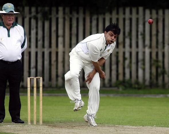 Crossflatts bowler Riaz Akram in action against Oakworth
