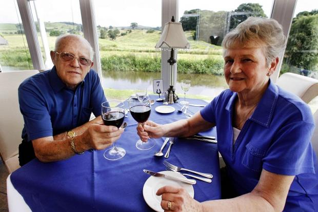 Gordon and Betty Whitham of Silsden enjoy a drink at their favourite holiday destinatio