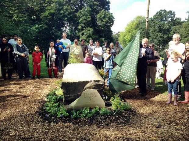 Keighley town mayor Councillor George Metcalf unveils the entrance stone to the new community garden