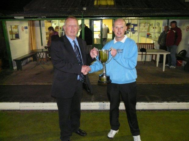Richard Hargreaves receives the trophjy from league president Warren Burnett