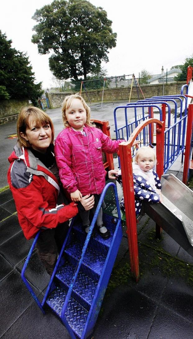 Jo Spencer and daughters Scarlett, four, and Martha, 18 months, in the park play area