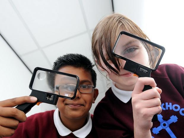 Abdul Mahmood and Bethany Wilson, from St Anne's Primary School, investigate a murder mystery at Keighley Civic Centre