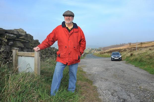 John Huxley in a car park overlooking Stanbury just outside the village of Haworth