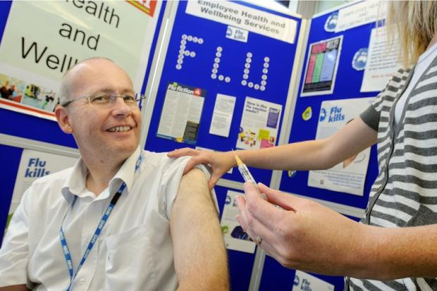 Medical director Andrew Catto has his flu jab at Airedale Hospital