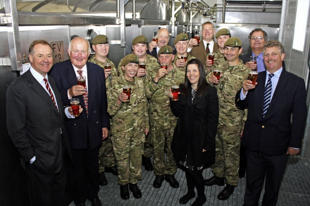 Keighley News: Charles Dent, left, and second brewer Andrew Leman, right, are joined at the brewery by soldiers of the 4th Battalion The Yorkshire Regiment for the first tasting of Havercake Ale
