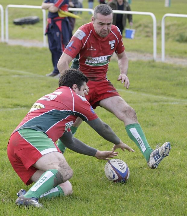 Rob Wilkinson is about to pounce for Keighley's first try as Micky Phillips looks on. Picture: Charlie Perry