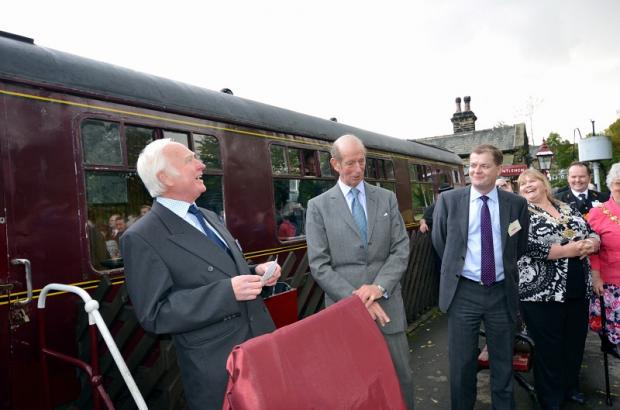 The Duke of Kent (centre) prepares to unveil a plaque to mark the return to service of the Lancashire & Yorkshire Railway Club Carriage