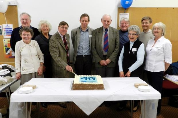 Peter Holden cuts the cake at the Keighley event