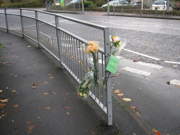 Flowers left at the scene of the fatal accident at the junction of Bradford Road and Grange Road, Riddlesden