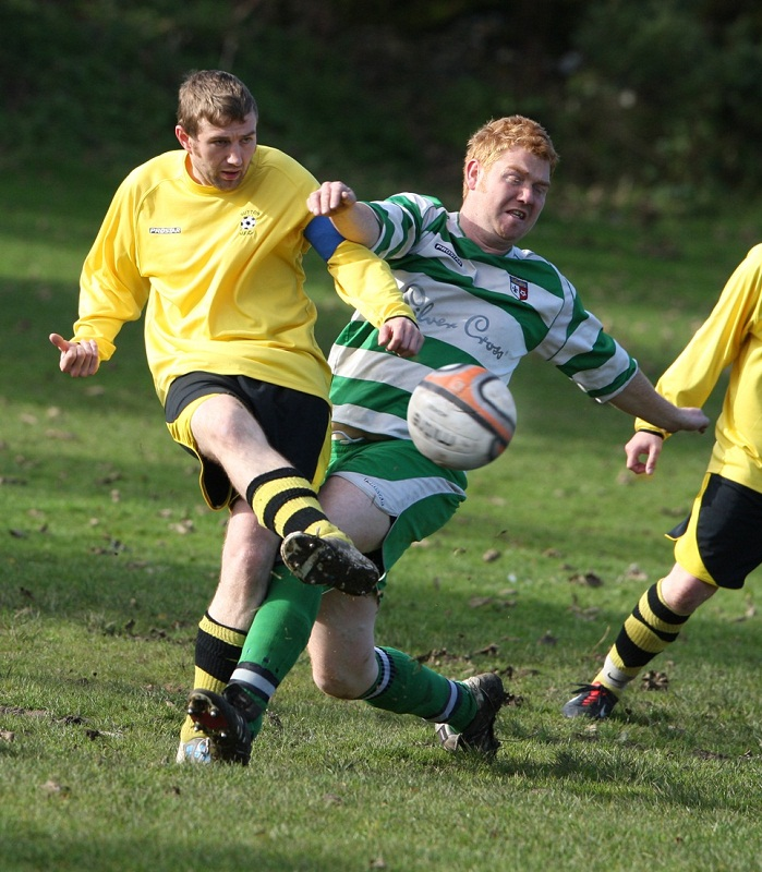 Sutton defender Phil Edwards breaks up a Grassington attack