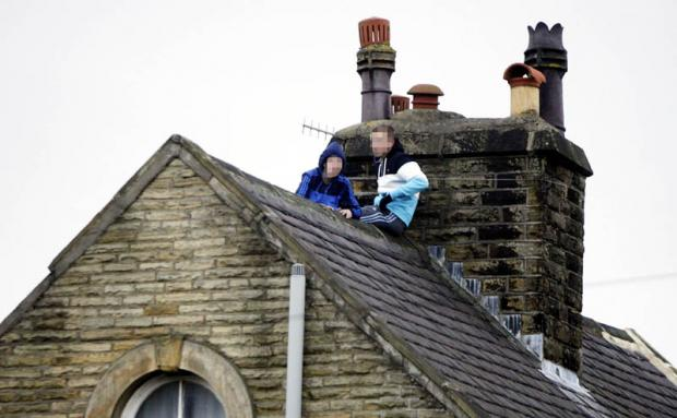 The young men on the roof of the building