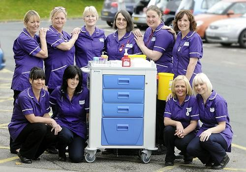 The phlebotomy team with their new purple uniforms