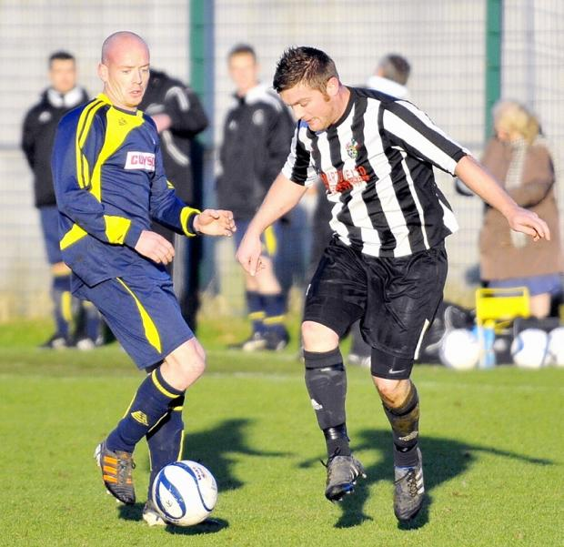Ilkley Town's Phil Thommesen, left, battles for possession with Ventus Yeadon Celtic's Gareth Clinch