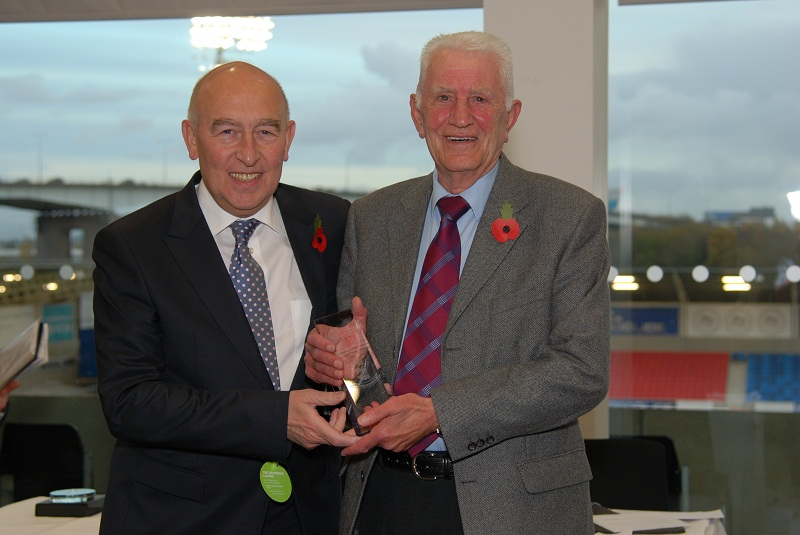 Jeremy Crowther, right, receives his Outstanding Contribution to English Schools award from acting RFL chairman Maurice Watkins