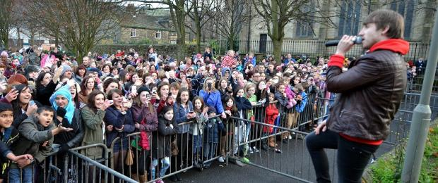X Factor finalist Kye Sones wows the gathered crowd, who were all straining to grab a picture of their pop idol