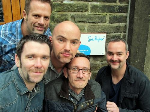 Keighley News: Paul Reynard, top left, with (from left) Martin Thompson, Ben Loftus, Marc Wilkie and Chris Mcloughlin, who are growing moustaches in aid of Manorlands. Picture by Craig Brotherton