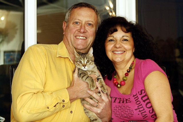 Craig and Jenny Scull with their cat, called Rocky, which they rescued from Spain during a holiday after finding him close to death