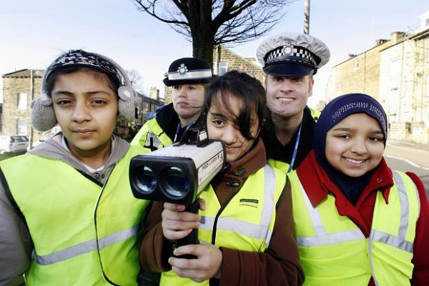l St Andrew's Primary School pupils (from left) Ayesha Arif, Esha Rukhsar and Zainab Ali join PCSO Kirsty Newton and PC Richard Hirst for the speed-