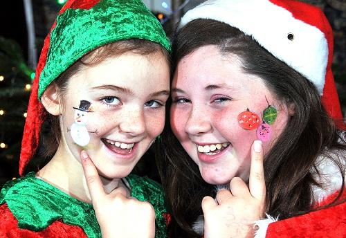 Keighley News: Faith Jordan, nine, and 12-year-old Jaime Lee show off their face paintings. Pictures by Richard Leach