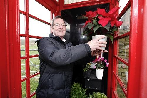 Tony Jones in the Marsh Lane phone kiosk he hopes will become a plant exchange
