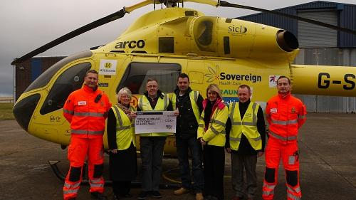 Steve Cochrane handing over a cheque to the Yorkshire Air Ambulance