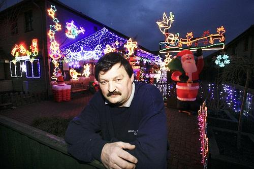Allan White with the Christmas display at his home in Litton Road, Keighley, in memory of his late wife Debra