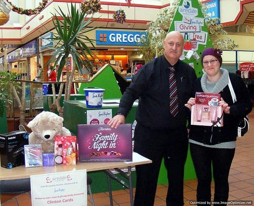 Kelly Taylor receives a Christmas hamper from Airedale Shopping Centre manager Steve Seymour