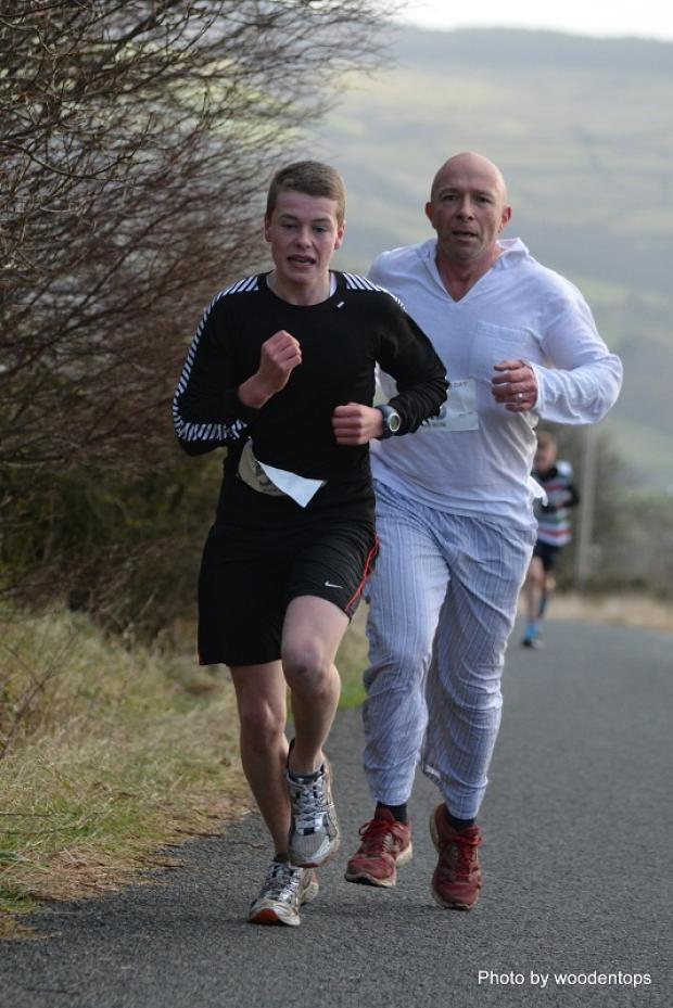 Keighley News: Winner Lucas Lee, right, and Harry Muir battle it out in the Silsden New Year Fun Run