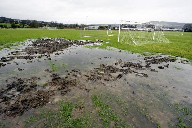 Keighley News: Waterlogged: Silsden Whitestar's pitch at Keighley Road last week