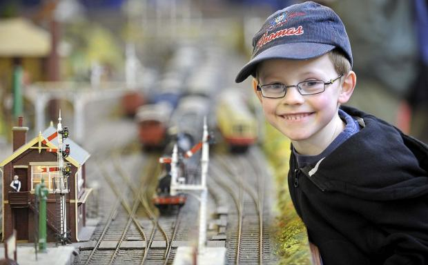Five-year-old Austin Davison excitedly watches the action on the tracks