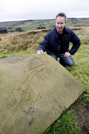 Stevan Tica with one of his sculptures on Penistone Hill, Haworth