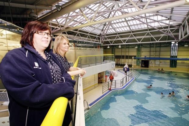 Keighley Leisure Centre staff Dawn Land, left, and Lisa Bennett at the newly reopened swimming pool