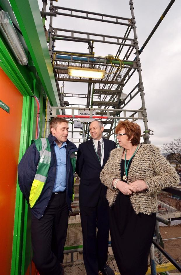 Keighley News: Project manager Jason Pink, vice-principal of corporate affairs Andy Welsh, and college principal Michele Sutton on site