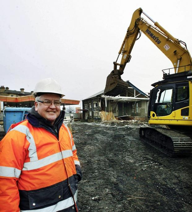 Keighley News: Sam Bailey, of Bingley Demolition, at the site being cleared for the Worth Valley Shopping Centre development