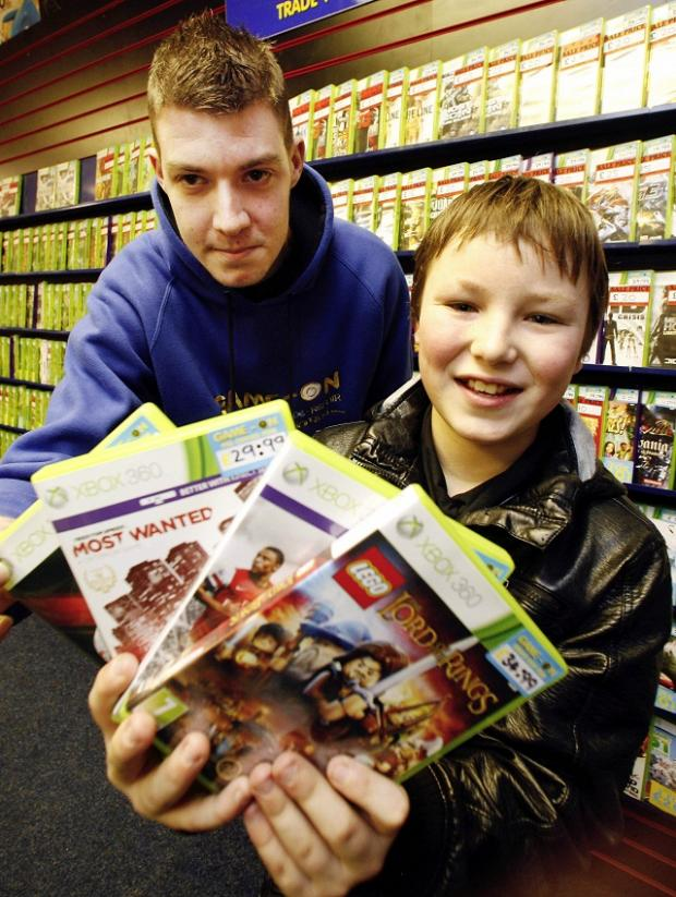 Liam Eastwood from the Game On store with Ben as he chose his first game.