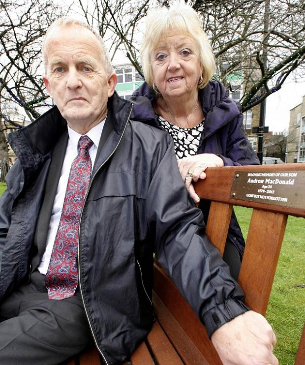 Robert and Shirley MacDonald with the bench installed in Keighley Town Hall Square in memory of their son Andrew