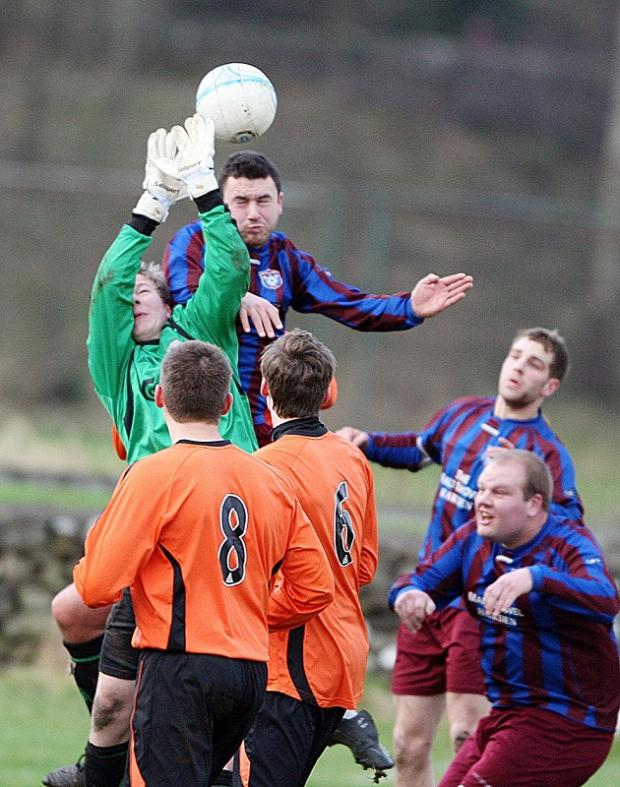 Settle keeper Sam Arrowsmith goes up for a high ball