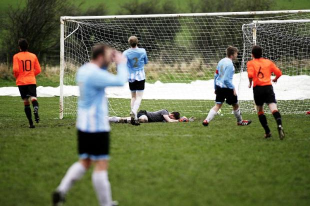 Whitestar keeper Jonny Rampling is distraught after Craig Morris gave Oxenhope the lead