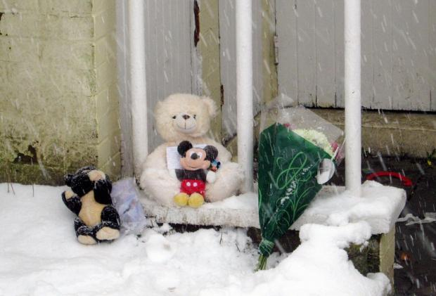 Tributes start to arrive at the house where a four-year-old boy was killed