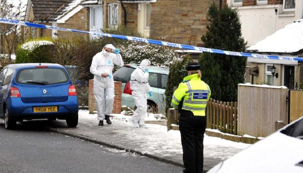 Keighley News: Forensic officers at the scene of the tragedy in Harewood Road, Bracken Bank
