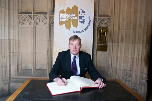 Keighley MP Kris Hopkins adds his signature to the Holocaust Memorial Day book of commitment
