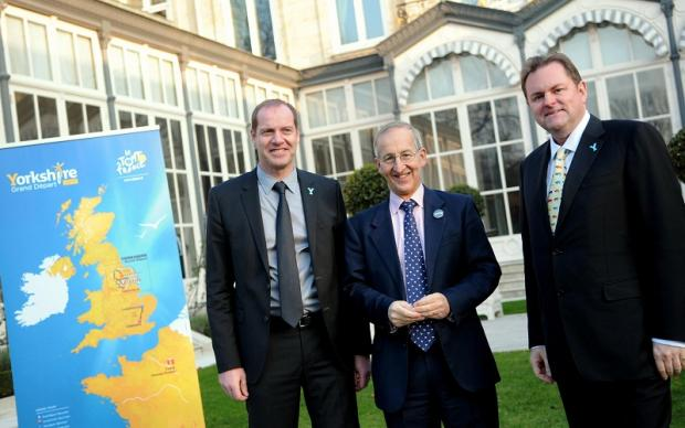 Welcome to Yorkshire chief executive Gary Verity, right, Tour de France director Christian Prudhomme, left, and British ambassador to France, Sir Peter Ricketts, pose during the presentation of the start of the 2014 Tour de France