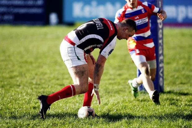 Adam Reardon touches down for Cougars under-23s
